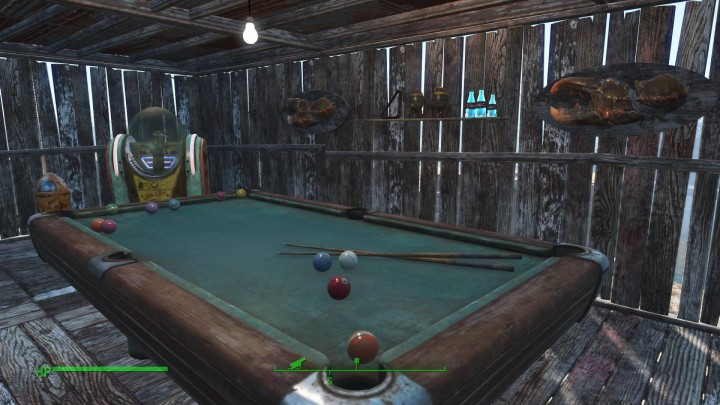 My perfectly arranged pool room. Complete with juke box and mini-nukes.
